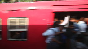 COLOMBO, SRI LANKA - FEBRUARY 2014: View of another train and local people trying to get in, from moving train. The Sri Lankan rai stock video footage
