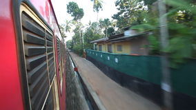 COLOMBO, SRI LANKA - FEBRUARY 2014: View of Colombo suburbs from passing train. The Sri Lankan railway transports millions of peop. Le daily in the country stock footage