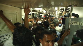 COLOMBO, SRI LANKA - FEBRUARY 2014: View of crowded local people traveling in train. The Sri Lankan railway transports millions of stock video