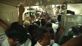 COLOMBO, SRI LANKA - FEBRUARY 2014: View of crowded local people traveling in train. The Sri Lankan railway transports millions of stock footage