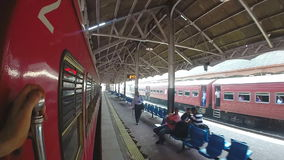 COLOMBO, SRI LANKA - MARCH 2014: Slow motion of train coming into the train station stock video footage