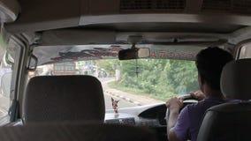 Colombo, Sri Lanka, november 15, 2011: Man drives the car. Passenger transportation stock video footage