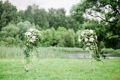 Colomns with flowers for werdding ceremony Stock Photography