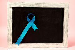 Colon cancer awareness poster. Blue ribbon made of dots on white background. Medical concept. stock image