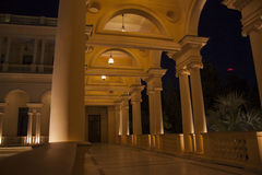 Colonade in the night. Beautiful villa in ancient greek classic style with landscaped green territory; outdoor panorama with copy space stock photography