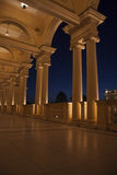 Colonade in the night. Beautiful villa in ancient greek classic style with landscaped green territory; outdoor panorama with copy space Royalty Free Stock Photography