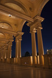 Colonade in the night. Beautiful villa in ancient greek classic style with landscaped green territory; outdoor panorama with copy space Stock Photo