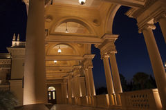 Colonade in the night. Beautiful villa in ancient greek classic style with landscaped green territory; outdoor panorama with copy space stock photos