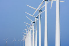 Colonade of windmills, facing the sky. Dutch colonade of windmills, facing the sky Royalty Free Stock Image