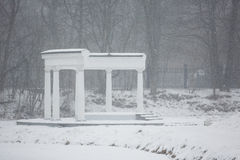 Colonade in winter. Colonnade in a park at winter time Stock Image