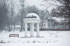 Colonade in winter. Colonnade in a park at winter time Royalty Free Stock Images