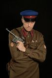 Colonel commander. With a gun on a dark background Stock Photos