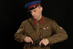 Colonel commander with a gun. On a dark background Stock Photo