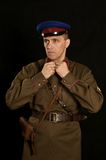 Colonel commander with a gun. On a dark background Royalty Free Stock Photography