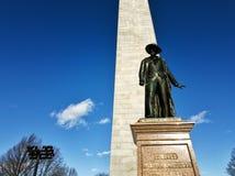 Colonel William Prescott statue and Bunker Hill monument. Photo of the Colonel William Prescott statue and the Bunker Hill monument captured on a sunny winter Royalty Free Stock Image