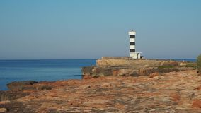 Colonia Sant Jordi, Mallorca, Spain. The lighthouse and the rocks around the village in the morning. Summer time stock footage