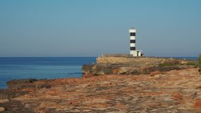 Colonia Sant Jordi, Mallorca, Spain. The lighthouse and the rocks around the village in the morning. Summer time stock video footage