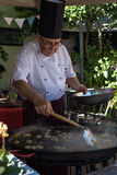 COLONIA, URUGUAY - APRIL 19, 2015: Traditional Chef cooking squi Stock Photo