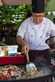 COLONIA, URUGUAY - APRIL 19, 2015: Traditional Chef cooking squi Stock Photography