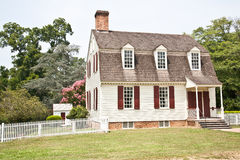 Colonial American Home. A small wooden cottage home with a quaint garden in the New England area of the United States built during the colonial period Royalty Free Stock Images