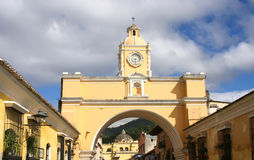Colonial arch. Yellow arch in old capital of Guatemala over sky stock image