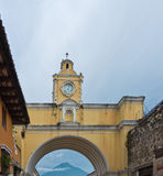 Colonial arch. Iconic Colonial Arch in Antigua, Guatemala. Volcan Augua is under the arch in the background Royalty Free Stock Image