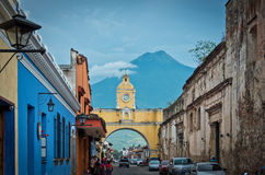 Colonial arch. Street view of the Iconic Colonial Arch in Antigua, Guatemala. Volcan Augua is in the background Stock Images