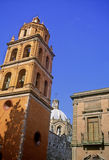Colonial architecture. Tower of San Francisco church, dome of temple del Carmen and colonial building at San Luis Potosi royalty free stock image