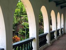 Colonial Architecture. A roofed porch that has arched columns Stock Image