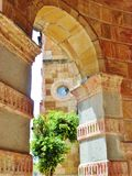 Colonial Architecture Viewed Through Stone Archway Stock Image
