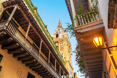 Colonial Balconies and Church. View looking up at historic colonial balconies and a church in Cartagena, Colombia Royalty Free Stock Photo
