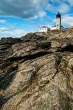 Colonial Beavertail Lighthouse on Rocky Coastline Stock Photography
