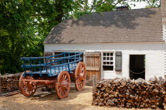 Colonial Building and Horsecart: Williamsburg, VA. A colonial barn and horse-cart in Williamsburg, Virginia Stock Photo