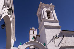 Colonial buildings in Sucre, Bolivia. Sucre, Bolivia in September 2015: The beautiful white historic churches and houses of Bolivias capital city are a popular Royalty Free Stock Photos