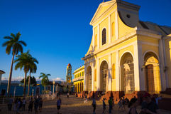 Colonial cathedral and clock tower in Trindad, Cuba. Trinidad, Cuba - December 29, 2015: Main square with colonial cathedral and clock tower Stock Photos