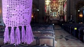 Colonial church interior Salvador Bahia Brazil. Purple crocheted chapel veil hanging at the entrance to an ornate colonial Brazilian church in Salvador, Bahia stock video footage