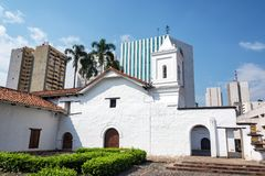Colonial Church and Modern Skyscrapers Stock Photos
