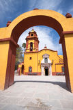 Colonial church seen through arch Royalty Free Stock Images