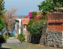 Colonial Cobbled Pathway to the Sea Stock Photos