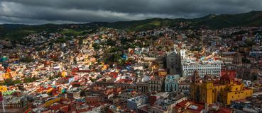 Colonial colorful traditional city and buildings of silver mining age in hill, Guanajuato, Mexico, American stock images