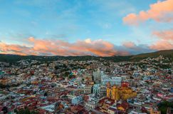 Colonial colorful traditional city and buildings of silver mining age in sunset hill, Guanajuato, Mexico royalty free stock image