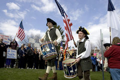 Colonial dressed drummers at tea party event. royalty free stock images