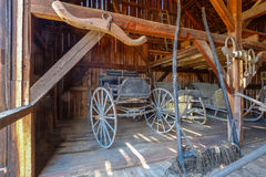 Colonial Era carriage wagon and sled storage barn of wood Royalty Free Stock Photography