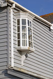 Colonial georgian cottage window feature. Photo of a vintage georgian window bay feature on weather boarded kent cottage Royalty Free Stock Photo