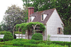 Colonial Home. A small colonial American home surrounded by lush gardens and courtyard Royalty Free Stock Images