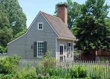 Colonial Home 81. A small colonial american home surrounded by lush gardens Stock Photos