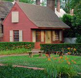 Colonial Home 94. A small colonial American home surrounded by lush gardens and courtyard Stock Image