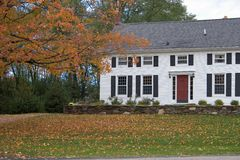 Colonial Home in Autumn. Colonial Home with Fall Foliage Stock Photos