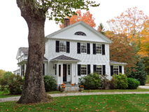 Colonial home in Connecticut with fall colors. A colonial home in southeastern Connecticut with fall foliage and autumn decorations Royalty Free Stock Photography