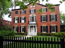 Colonial House with brick walls. Colonial house in Alexandria Virginia USA with beautiful entrance through green yard Stock Photography